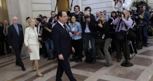 François Hollande arrives at city hall in San Francisco yesterday.  Photograph: Marcio Jose Sanchez/AP