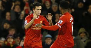 Liverpool's Philippe Coutinho (left) celebrates with   Daniel Sturridge after scoring  against Fulham. Photograph: Eddie Keogh/Reuters