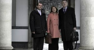 GSOC commissioners Kieran Fitzgerald, Carmel Foley and Simon O'Brien arriving at Leinster House yesterday. Photograph: Brenda Fitzsimons / THE IRISH TIMES