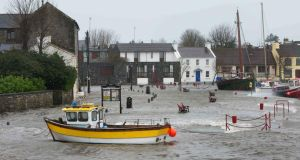 The flooded quayside at Kinvara, Co Galway, during the storm yesterday. Photograph: Joe O'Shaughnessy