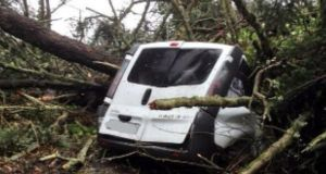 A van crushed by a tree near Meelick in Co Limerick. The vehicle was unoccupied at the time. Photograph: Andrew Carey via Twitter