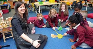 Éilis O'Brien with senior infants in the Doodle Den club at the Sacred Heart Junior School, Killinarden,Tallaght, Co Dublin. Photograph:Eric Luke