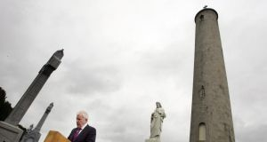 Jimmy Deenihan, Minister for Arts, Heritage and Gaeltacht Affairs, addressing a Daniel O'Connell Commemoration ceremony near the O'Connell Tower in Glasnevin Cemetery. Photograph: Alan Betson / THE IRISH TIMES