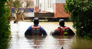 Police divers patrol the village of Wraysbury, Berkshire in the UK on Wednesday. Britain's flooding situation continues to worsen. Photograph: Facundo Arrizabalaga/EPA