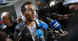 French footballer Zahir Belounis on his return to Paris after being  detained in Qatar for more than two years due to exit visa laws. Photograph:  Thomas Samson/AFP/Getty Images