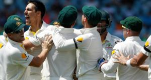 Australia's Mitchell Johnson  celebrates with team-mates after the dismissal of South Africa's captain Graeme Smith during the second day of the first Test match in Centurion, South Africa. Photograph: Siphiwe Sibeko/Reuters