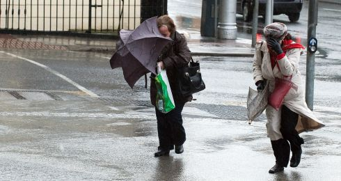 Members of the public brave the bad weather in Dublin today. Photograph: Collins