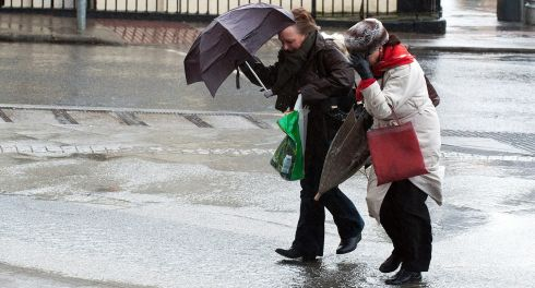 Battling the elements in Dublin today. Photograph: Collins
