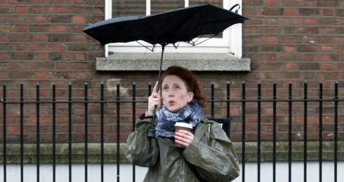 Trying to keep an umberella aloft on Kildare Street in Dublin today. Photograph:  Gareth Chaney/Collins