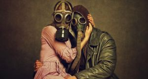 Mixed-up metaphors: a couple in gas masks, bizarrely meant to denote everlasting love. Photograph: Getty