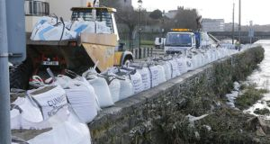 A section of a 2km line of sandbags along the Shannon river at St Mary's Park, Limerick. Photograph: Liam Burke/Press 22