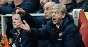 Arsenal manager Arsene Wenger says his side are in the title race. Photograph: Andy Rain/EPA