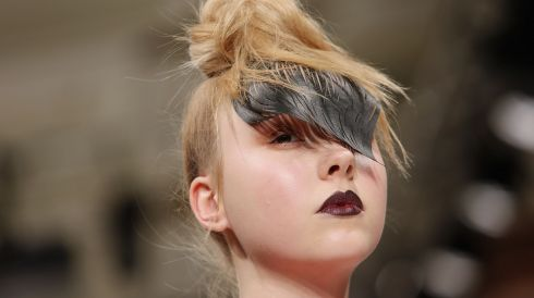 February 14 marks the beginning of London Fashion Week. What better way to open a gallery dedicated to all things fashion than with a girl wearing a... wing on her head?   Here we have a model on the runway at the Lulu Liu show. Photograph: Tim P. Whitby/Getty Images