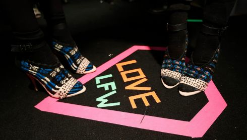 Models teeter in their heels on Valentine's Day street art backstage before the Bora Aksu Autumn/Winter 2014 collection show. Photograph: Suzanne Plunkett/Reuters