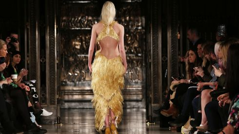More animal inspiration on the catwalk - a bit like a golden phoenix?  The Felder Felder show at Freemasons Hall, London. Photograph: Tim P. Whitby/Getty Images