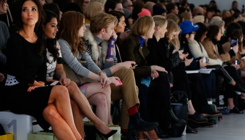 What would a catwalk be without a few celeb spectators to spice it up. Here's singer/presenter Myleene Klass, singer Vanessa White and socialite Henry Conway at the Jean-Pierre Braganza show. Photograph: Tristan Fewings/Getty Images