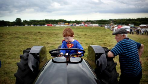 Supermen: A view from the Trim Hay-Making Festival, Co. Meath. Photograph: Tom Honan, Irish Mail on Sunday (1st prize in  Daily Life & People)