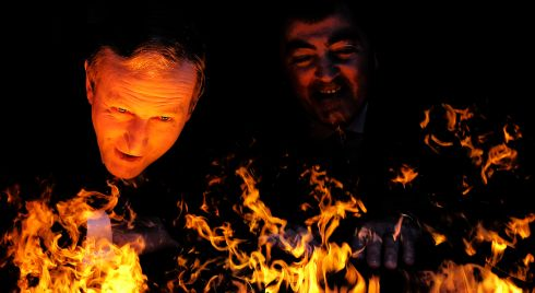 Out of the frying pan...?: Taoiseach Enda Kenny peers through an artificial fire at the opening of new facilities at Glen Dimplex. Photograph: Julien Behal/Maxwell Photography (1st in  Politics)