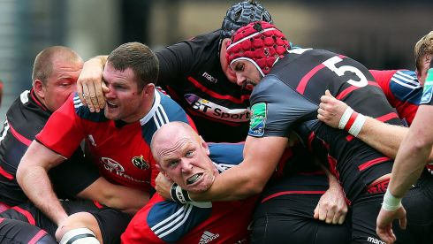 As tough as they come: Munster's Paul O'Connell and Donnacha Ryan, with Sean Cox and Grant Gilchrist, of Edinburgh, during a Heineken Cup match. Photograph: Dan Sheridan/Inpho. (1st place in Sports Action)