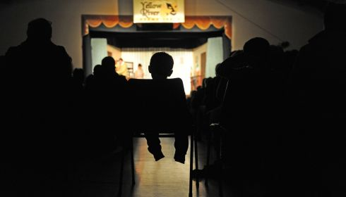 High chair: A young boy has his chair placed in the aisle, for an unobscured view, during a performance by the Yellow River Drama Group. Photograph: Barry Cronin/Barry Cronin Photography (2nd place in Arts & Entertainment)