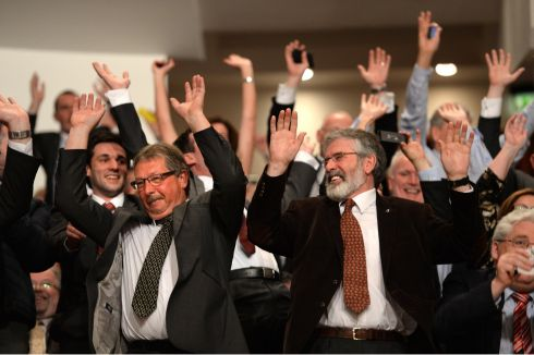 Put your hands up in the air:  Democratic Unionist Party MLA Sammy Wilson and Sinn Féin leader Gerry Adams take part in a Mexican wave before the arrival of President Barack Obama in Belfast. Photograph:  Dara Mac Donaill/The Irish Times (2nd in Politics)
