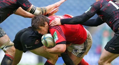 O'Callaghan is stopped in his tracks against Edinburgh in 2013. Photograph: Billy Stickland/Inpho