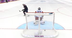 TJ Oshie scores the winning goal for the USA against Russia. Photograph:  Al Bello/Getty Images