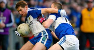 Ballinderry's Darren Lawn challenges St Vincent's Conleth Gilligan in Newry. Photograph: Russell Pritchard/Inpho