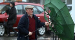 A man struggles with an umbrella during stormy weather this week in Ballymena, Co Antrim. Photograph: Paul Faith/PA Wire