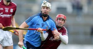 Niall Healy of Galway (right) with Michael Carton of Dublin at Pearse Stadium. Photograph: Donall Farmer/Inpho