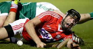 Cork's Mark Ellis feels the effects of a collision against a Limerick player during the Allianz Hurling League Division 1B clash at  Páirc Uí Rinn in Cork. Photo: Ryan Byrne/Inpho   ,