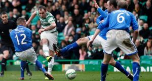 Celtic's Anthony Stokes (second left) scores his third   against St Johnstone   at Celtic Park. Photograph:  Russell Cheyne/Reuters