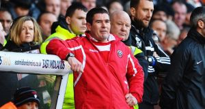 Nigel Clough (centre), the Sheffield United manager, looks on from the touchline during the FA Cup fifth round match against Nottingham Forest at Bramall Lane. Photograph:  Michael Regan/Getty Images