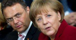 German chancellor Angela Merkel with former  agriculture minister Hans-Peter Friedrich, whom she fired  last Friday after he admitted telling the Social Democratic Party – but not her – last year that one of its MPs had been named in a swoop on a Canadian child pornography ring. Photograph: Reuters/Thomas Peter
