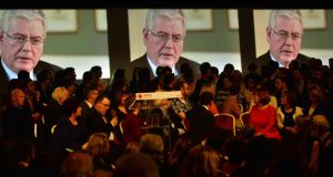 Labouring the point: Tánaiste Eamon Gilmore projected on screens during a video at the party conference in Enfield on Saturday. Photograph: Alan Betson