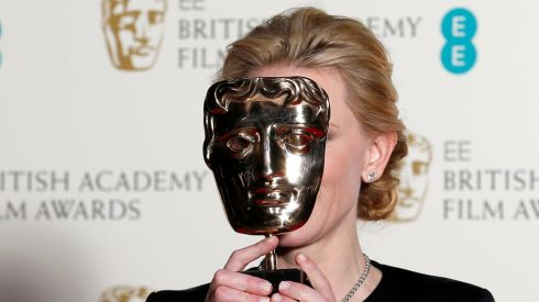 Cate Blanchett celebrates winning Best Actress for Blue Jasmine at the British Academy of Film and Arts (BAFTA) awards ceremony at the Royal Opera House in London . Photograph: Suzanne Plunkett/Reuters