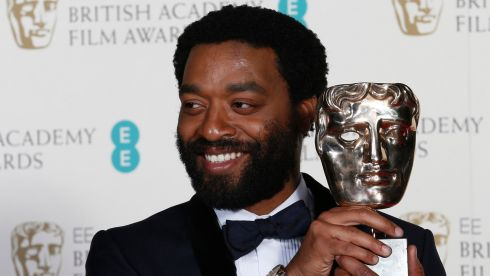 "Actor Chiwetel Ejiofor celebrates after winning Best Actor for ""12 Years a Slave"" at the Baftas ceremony at the Royal Opera House in London Photograph: Suzanne Plunkett /Reuters"