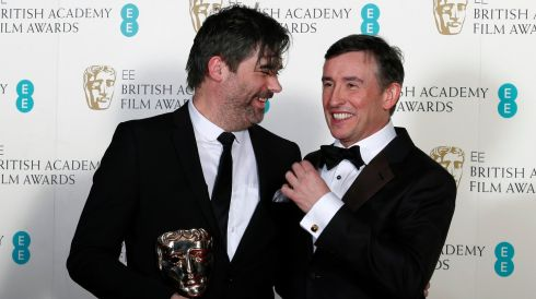 "Actor Steve Coogan (R) who won Best Adapted Screenplay for Philomena poses for a photograph with Kieran Evans, the winner of the Outstanding Debut By A British Writer, Director or Producer category for ""Kelly + Victor"", at the British Academy of Film and Arts (BAFTA) awards. Photograph: Suzanne Plunkett /Reuters"