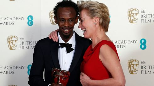 "Barkhad Abdi (L) celebrates winning Best Supporting Actor for ""Captain Phillips"" with Emma Thompson at the BAFTAs. Photograph: Suzanne Plunkett /Reuters"