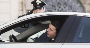 A guard salutes as Matteo Renzi, the leader of the centre-left Democratic Party (PD), arrives at Quirinal palace in Rome where president Giorgio Napolitano invited him to form a government. Photograph: Allesandro Di Meo/Reuters.