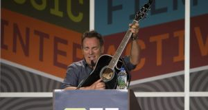 Bruce Springsteen plays the guitar as he delivers the keynote address at the South by Southwest (SXSW) Festival in Austin, Texas in 2012. The event, which also comprises trade shows and gaming exhibitions, is on the agenda for Enterprise Ireland this year. Photograph: Brian Birzer/Reuters