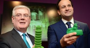 Tánaiste and Minister for Foreign Affairs and Trade Eamon Gilmore (left), and Minister for Transport, Tourism, and Sport , Leo Varadkar, at the launch of Tourism Ireland Global Greening 2014 , in Dublin last Wednewsday. The annual initiative sees a variety of major landmarks around the world turn green for St Patrick's Day. Photograph: Eric Luke / The Irish Times