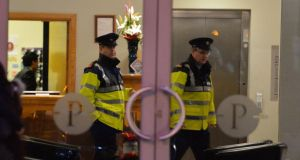 Gardai are seen at  the Plaza Hotel in Tallaght yesterday  where the body of a woman was  found in a room at the hotelPhotograph: Alan Betson/The Irish Times