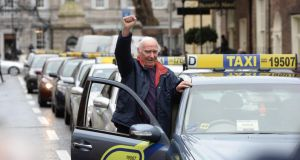 Taxi driver Christopher Gorman from Glasnevin takes part in a protest on Molesworth Street outside the Dail in mid-January 2014. Photograph: Alan Betson/The Irish Times