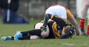 Colm Cooper after he had fallen awkwardly under a challenge when kicking for a point in O'Moore Park on Saturday. A scan later revealed  his anterior cruciate ligament had been ruptured.