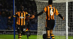 Yannick Sagbo of Hull City celebrates  with Curtis Davies after scoring his side's equaliser in the FA Cup fifth round tie against Brighton  at Amex Stadium. Photograph: Mike Hewitt/Getty Images