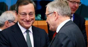 European Central Bank president Mario Draghi and European Stability Mechanism managing director Klaus Regling (right) attend an eurozone finance ministers meeting in Brussels on February 17th, 2014. Photograph: Francois Lenoir/Reuters