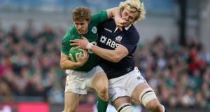 Ireland's Andrew Trimble tackled by Richie Gray of Scotland. Photograph: Dan Sheridan/Inpho