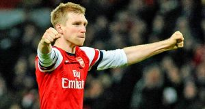 Arsenal's Per Mertesacker celebrates after the FA Cup fifth round  match against Liverpool.  Photograph: Gerry Penny/EPA