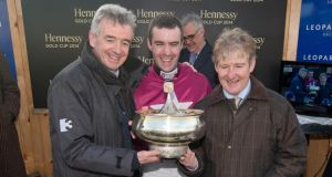 Owner  Michael O'Leary, jockey Brian O'Connell and trainer Phillip Fenton celebrate Last Instalment's win in the 2014 Hennessy Gold Cup at Leopardstown early in February. Photograph: Inpho